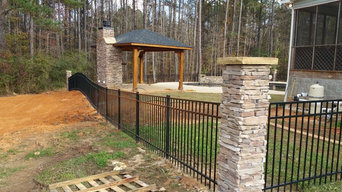 Aluminum fence with stone columns