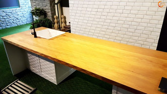 Teak table top cladding@ Vegas Interior Office