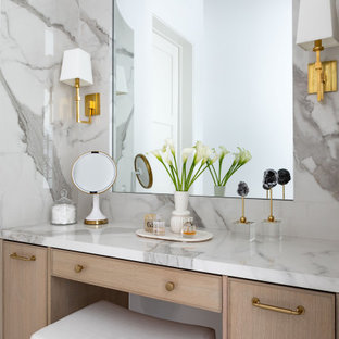 Example of a huge transitional master gray tile marble floor and gray floor bathroom design in Houston with light wood cabinets, white walls, a drop-in sink, a hinged shower door and a built-in vanity