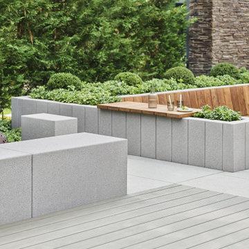 Moderne Sitzecke aus Holz und Beton