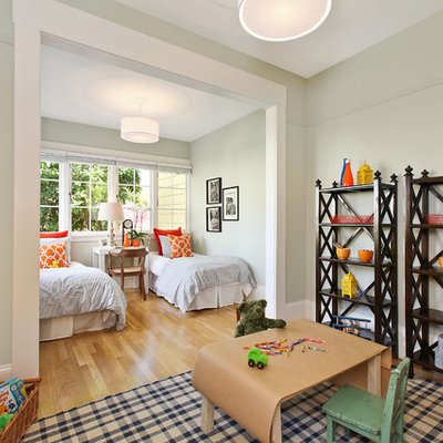 Inspiration for an eclectic gender-neutral light wood floor kids' room remodel in San Francisco with gray walls