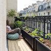 A Family Fills a Paris Balcony With Good Things to Eat
