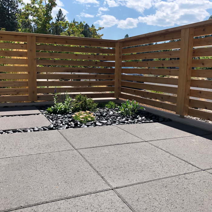 This modern space offers maximum outdoor living for the homeowners with minimum maintenance with the use of 2' x 2' paver slabs, Mexican Beach Pebble and River Rock Mulch, drought tolerant plant mater
