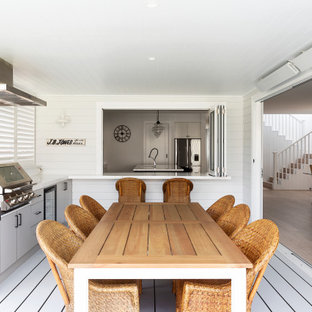 This is an example of a large beach style deck in Sydney.