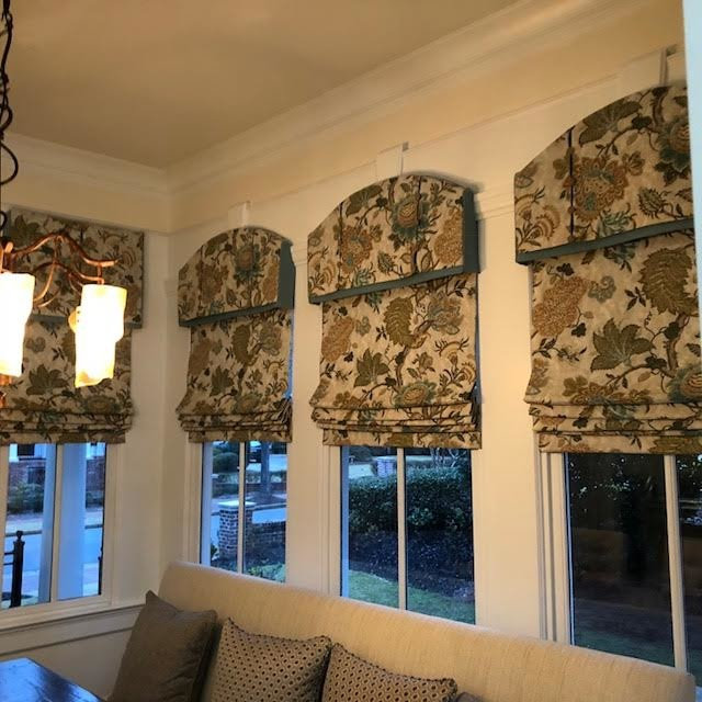 Arched Cornice with Motorized Roman Shades