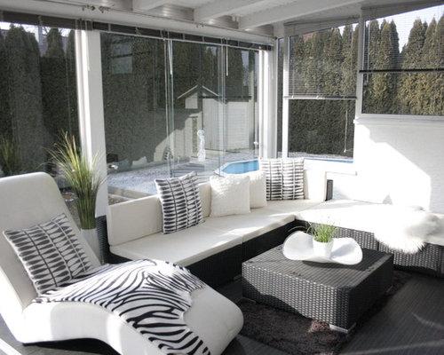 Foto e idee per verande veranda con camino classico e for Proiettato in veranda con camino