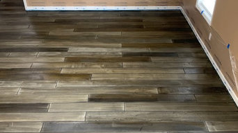 Hand taped wood stained concrete