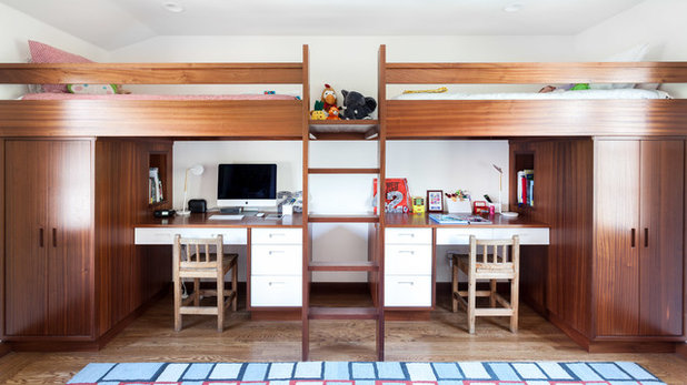 Cool Built in bunk beds with desks and storage underneath were designed for the twins ucIt us a very tailored look that repeats the white cabinetry with wood trim