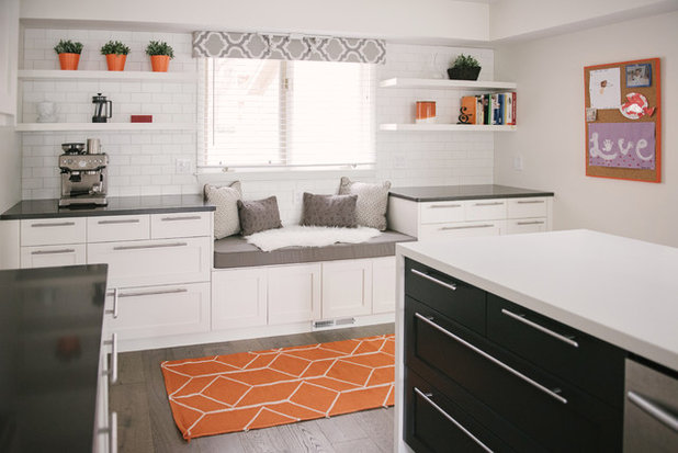Cute Here you can see how the dark countertops and island cabinets create contrast in the mostly white kitchen