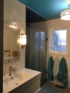 Cool We love the recycled glass tile we used and the wonderful watery feel it gives the bathroom Also putting in a horizontal herringbone helps to make the