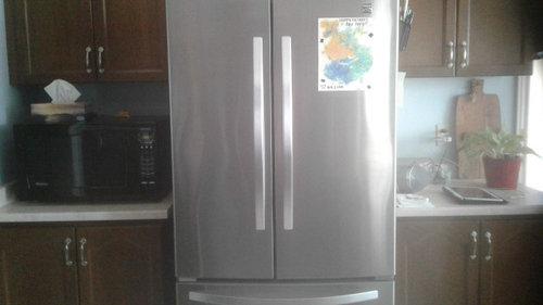 How do I install backsplash in this kitchen?