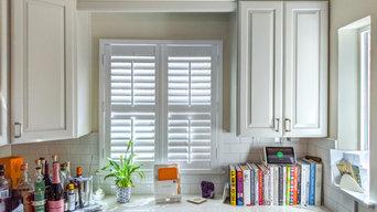 Light, airy kitchen in white plantation shutters