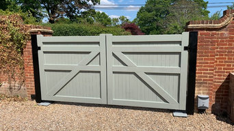 Hardwood gates painted a Farrow&Ball colour to match the windows of the house