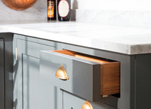 What is the brand and finish of the cabinet harware? Love this kitchen