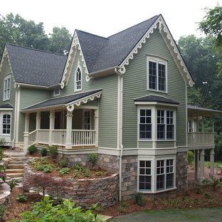 Large traditional green three-story wood gable roof idea in Grand Rapids with a shingle roof
