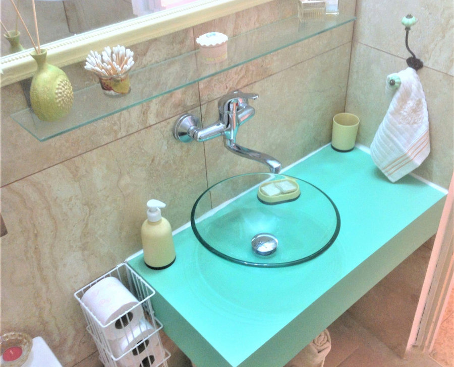 custom turquoise vanity with classy glass sink