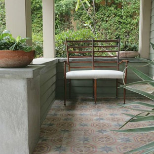 This Is An Example Of A Small Craftsman Tile Front Porch Design In Los Angeles With