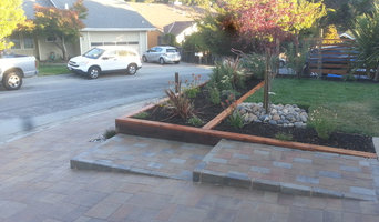Belmont-Paver driveway and water landscaping.