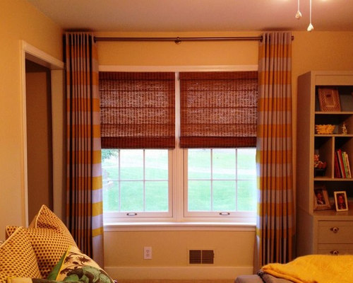horizontal stripe grommet top drapery over woven shades - Curtains