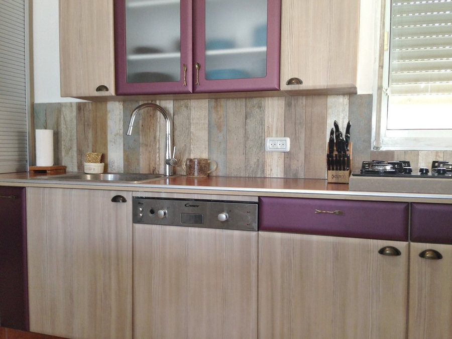 textured cabinets (creams/lilac/beige) mixed with deep purple