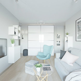 Design ideas for a small scandinavian open plan living room in Other with grey walls, laminate floors, a wall mounted tv and pink floors.