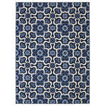 """Mohawk - Mohawk Home Woodbridge 7'6""""x10' Rug - Patterned after traditional tile artistry, the Marjorelle Gardens is another to play with the trend of Moroccan art. Crafted in cool colors of indigo, aqua and sand, this one reminds us of the beauty that lays on and off the Mediterranean coast. The Marjorelle Gardens rug is constructed of 100% Mohawk Exclusive Wear-Dated Nylon, a premium fiber that promises proven wear-free performance, and is reinforced by our durable latex backing for a quality you can trust.Features:"""