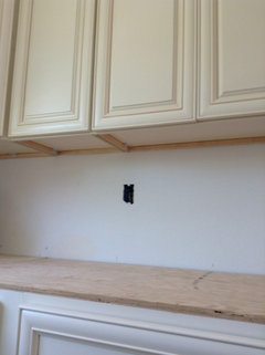 Underside Of Painted Upper Kitchen Cabinets