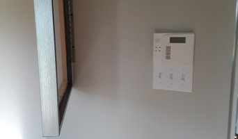 Hiding a security or thermostat with a picture.