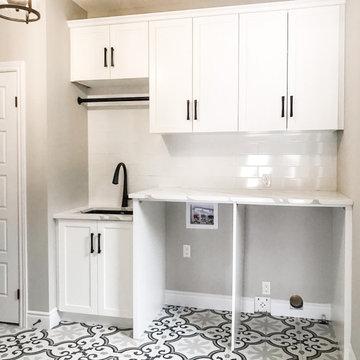White Shaker & Patterned Tile Laundry Room