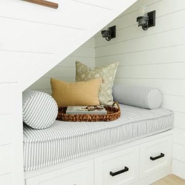 Coastal modern farmhouse stairwell nook bench shiplap