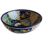"""Fine Crafts & Imports - Janitzio Round Ceramic Talavera Vessel Sink - This bathroom vessel sink has a dark blue border and is by far one the most colorful and detailed Talavera ceramic vessels we have in our website. It is intended to be over-mounted. Its exterior surface is painted as well as the interior one. It has a round base (where it sits) about 6 in diameter and 1"""" tall, which means, the inside dimensions are about 14"""" by 4 1/2"""" deep. It doesn't have an overflow system and a standard 1.5"""" drain opening."""""""