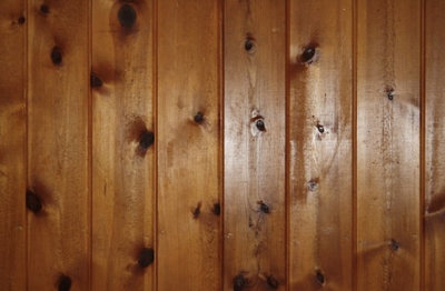 by Christina Katos - Knotty To Nice: Painted Wood Paneling Lightens A Room's Look
