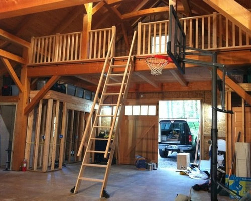 Vertical grain fir rolling ladder loft system in timber for A frame garage with loft