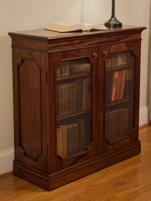 traditional mahogany bookcase with brass grilles