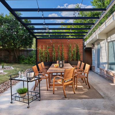 Mid-sized 1950s backyard concrete patio photo in Austin