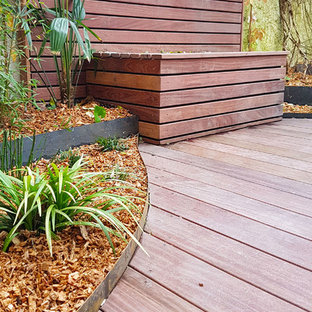 Design ideas for a medium sized world-inspired back patio in Nantes with decking and an awning.
