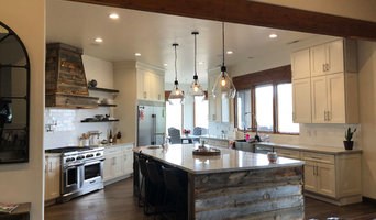 Farmhouse style kitchen with barnwood hood