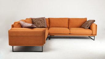 Bespoke Industrial burnt orange corner sofa with elegant steel legs.