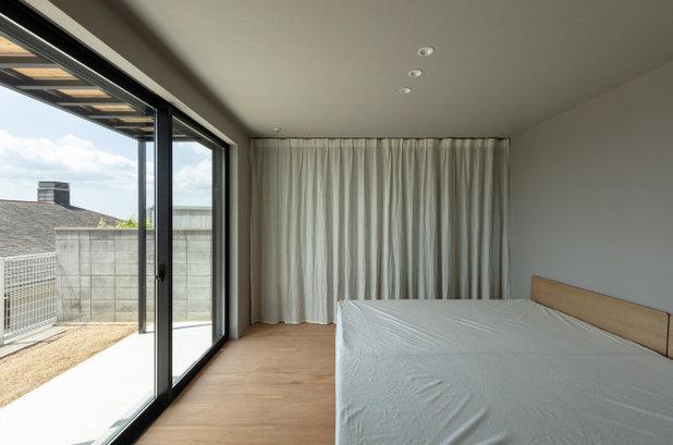モダン 寝室 by SQOOL一級建築士事務所