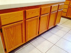 How do I downplay honey oak cabinets on a budget??