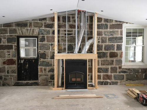 Wood Fireplace Surround Against Existing Stone Wall