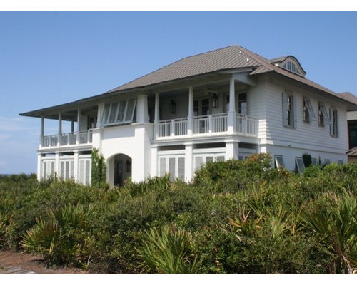 Example of an island style home design in New Orleans Caribbean House Plans  Houzz