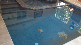 Luxury swimming pool renovation - Glass pool, glass bead plaster, glass tile