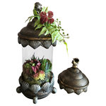 """SilkInBloom - Succulents in a Glass Castle - Unique Floral arrangement of various types of Succulents in a Coastal Glass Container in the shape of a Dome. Size 15""""H X 6.5""""L X 6.5""""D. Distressed cylinder container in combination of Gold and Bronze colors beautifully compliments burgundy, dark orange and green Succulents. The top of the Dome decorated with light Green Fern leaf and burgundy succulent adds a touch of softness to the design.  Dining room Buffet or Console table in your Foyer or Living room would make a perfect spot for couple of these arrangements. A single piece would look great as well anywhere in your home. Treat yourself and enjoy this stunning design for years to come! Also great as a gift for your friends or loved ones. Handmade with love by Boston Floral Designer."""