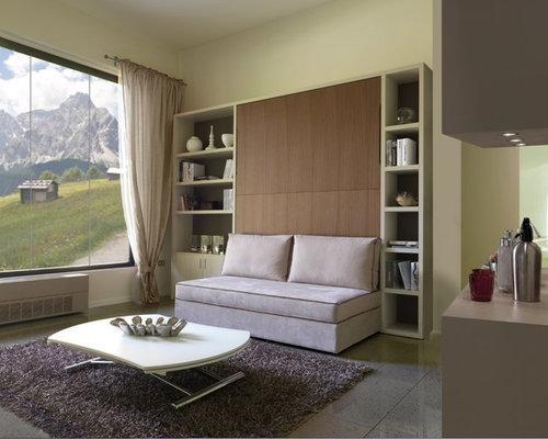 Libreria sopra divano idee per il design della casa - Libreria con letto a scomparsa ...
