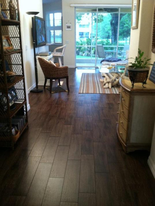 Dark Tile Flooring love the cut if the tile floors and the one pane non framed cabinets Saveemail
