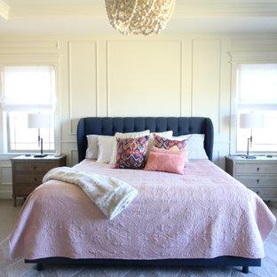 Großes Klassisches Hauptschlafzimmer mit weißer Wandfarbe, Teppichboden, Eckkamin, gefliester Kaminumrandung, beigem Boden, Holzdielendecke und vertäfelten Wänden in Denver