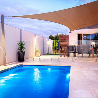 Inspiration for a modern tile and rectangular pool remodel in Dallas