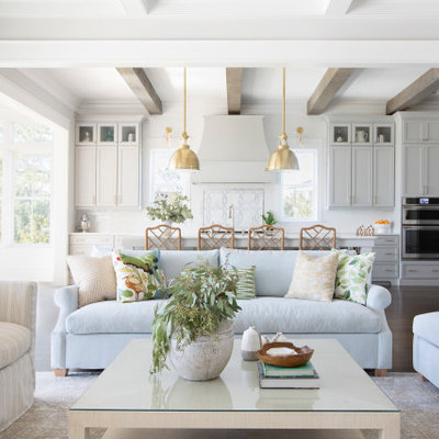 Example of a beach style home design design in Charleston