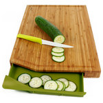 "Neoflam - Hilo Bamboo Cutting Board With Tray, Green - The Neoflam Bamboo Cut2Tray extends beyond the scope of its cutting board competitors; in addition to having a 12"" x 18"" cutting surface, the Bamboo Cut2Tray comes with a sliding tray that conveniently collects the food you slice and chop. This allows for the easy transference of food from cutting board onto your pot, pan, or plate. Juice grooves collect excess liquids from spilling onto your counter top by disposing the liquid runoff into the tray akin to tributaries flowing into a lake. You can also remove and clean the tray in the dishwasher after each use."